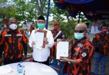 Pengurus dan kader Majelis Pimpinan Cabang (MPC) Pemuda Pancasila (PP) Kabupaten Sidoarjo totalitas memenangkan duet pasangan calon bupati dan wakil bupati Sidoarjo nomor urut 3, Kelana Aprilianto dan Dwi Astutik di Pilkada Sidoarjo 2020.
